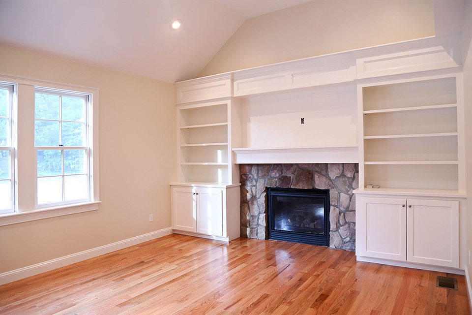 built in bookcase and fireplace