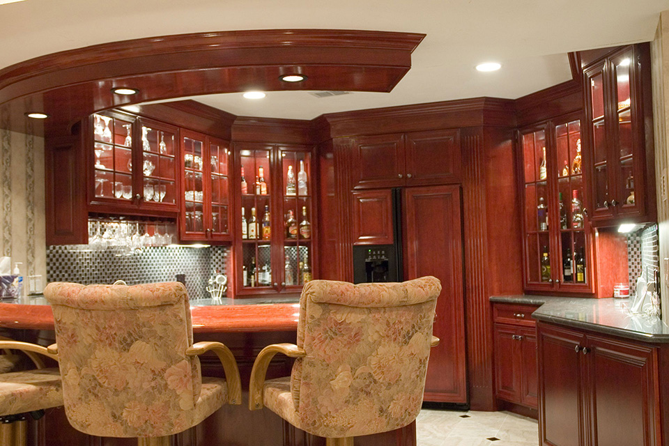 bar with custom woodwork and cabinets