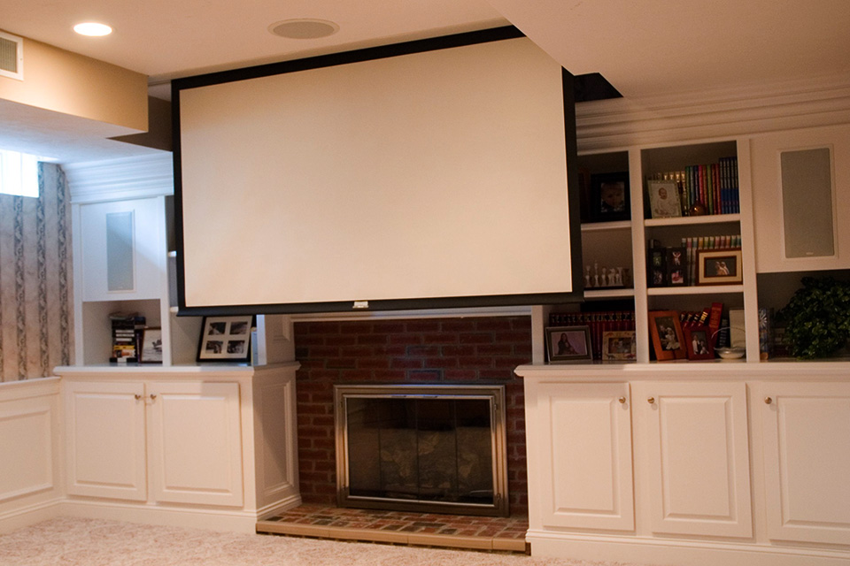 finshed basement with fireplace and home theater